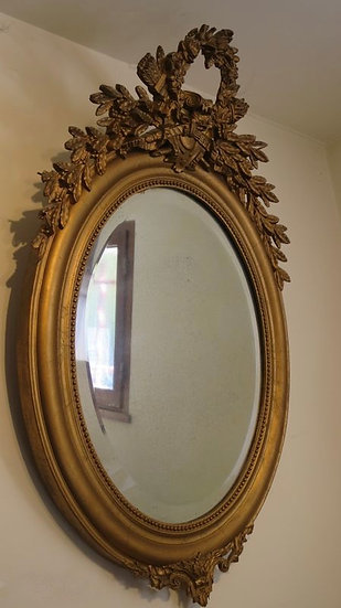 19th Century Oval French Mirror With Gilded Floral Theme - SOLD
