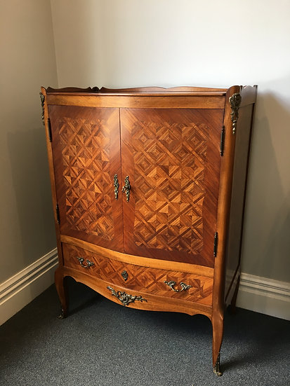 Elegant Cupboard with Inlaid Wood and Intricate Ornaments - SOLD