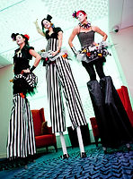 three ladies on stilts