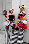 Ladies walking on stilts