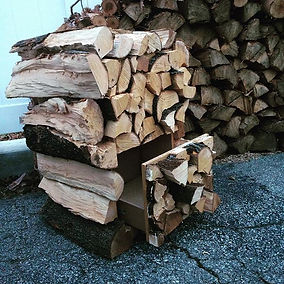 Two drawer filing cabinet with firewood facade. Created by Arbor-Craft.