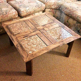 Coffee table made of reclaimed pallet wood, pennies, and epoxy. Created by Arbor-Craft.