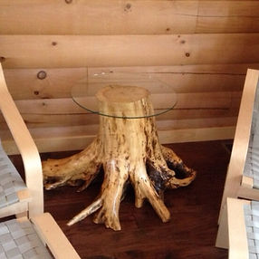 Stump table with glass top. Created by Arbor-Craft.