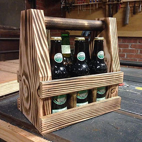 Beer tote made from Douglas Fir finished with the Shou-sugi-ban technique. Created by Arbor-Craft.