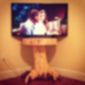 Spruce stump table. Created by Arbor-Craft.