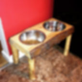 Live edge Pine dogbowl stand with log legs. Created by Arbor-Craft.
