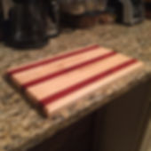 Maple and Padauk cutting board. Created by Arbor-Craft.