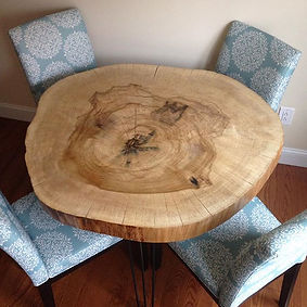 Live edge Tulip Poplar dining table on steel hairpin legs. Created by Arbor-Craft.