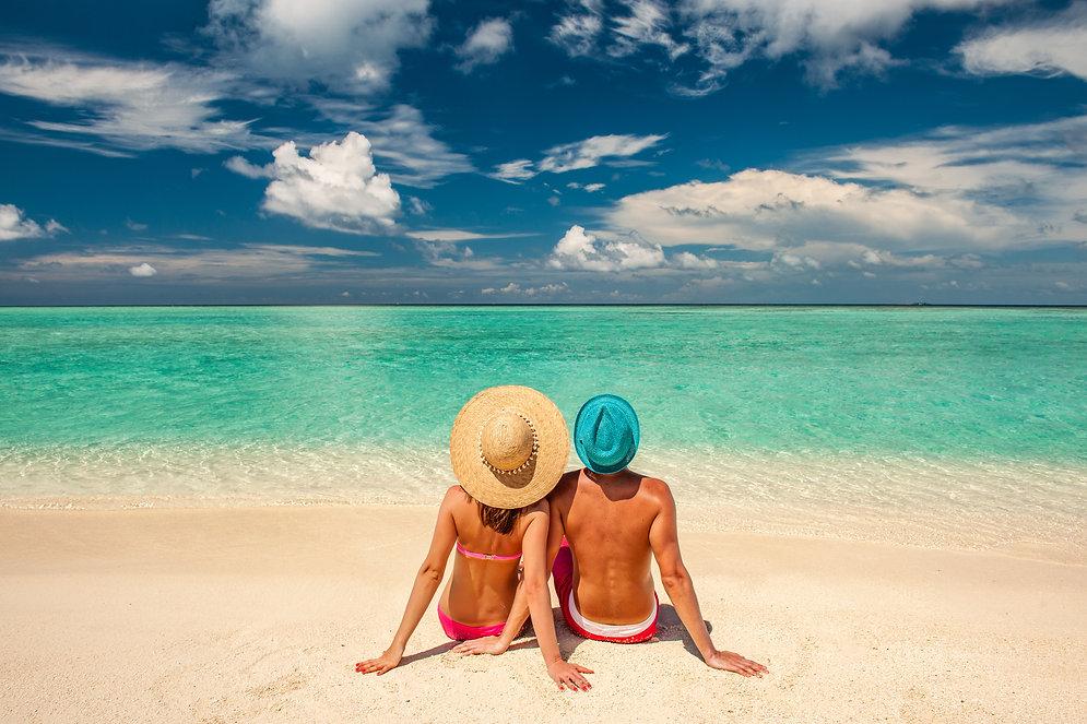 couple-on-a-beach-two-hats.jpg