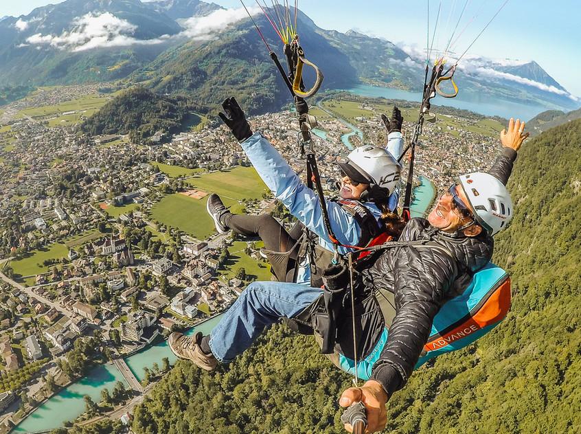 Lindsay and Pilot Paragliding Over Interlaken