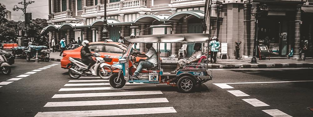 Tuk Tuks in street