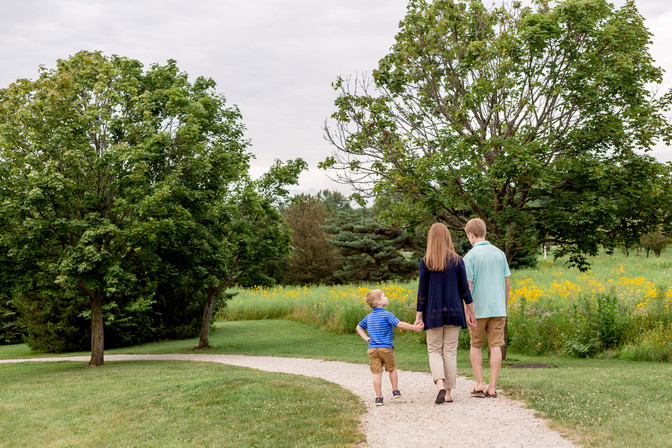 Photo of a family walking on a path