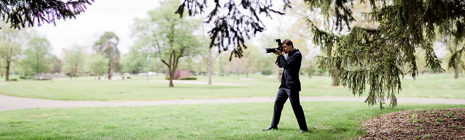 A photographer taking a picture in a photoshoot