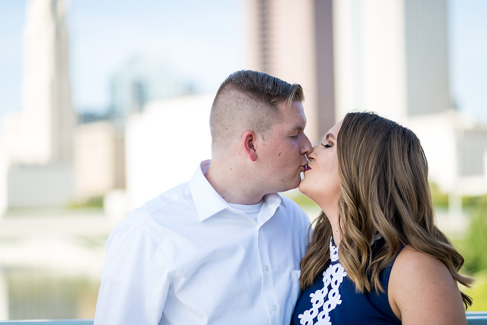 Couple kissing by the Columbus Skyline