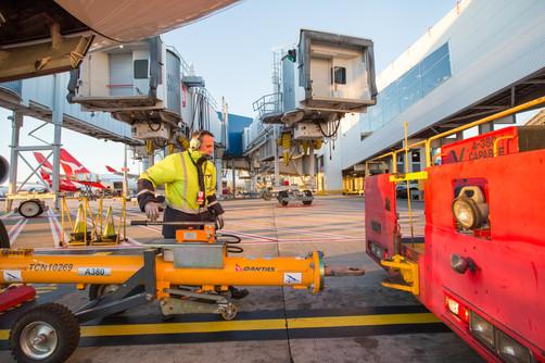 Qantas Engineer preparing aircraft for departure.