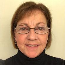 blonde female wearing glasses smilling board member leadership team professional headshot