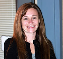 brunette female smiling leadership team director professional headshot
