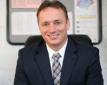 brunette male smiling leadership superintendent professional headshot
