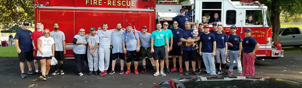athletes softball baseball group team picture fire truck first responders firemen firefighter Miami County Magic Special Olympics sports program