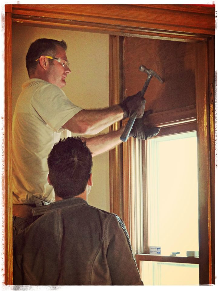 Charlie and Antonio working on window.jpg