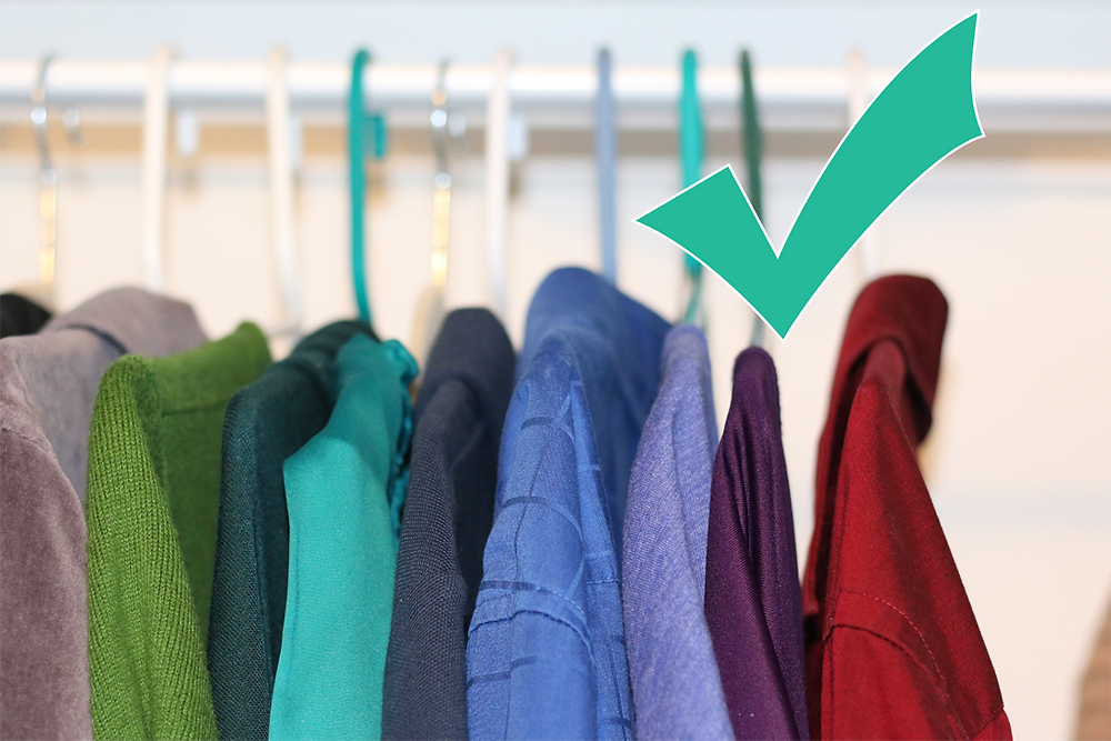 Shirts hanging on rack in jewel tones of emerald green, teal, sapphire blue, navy blue, violet and ruby red