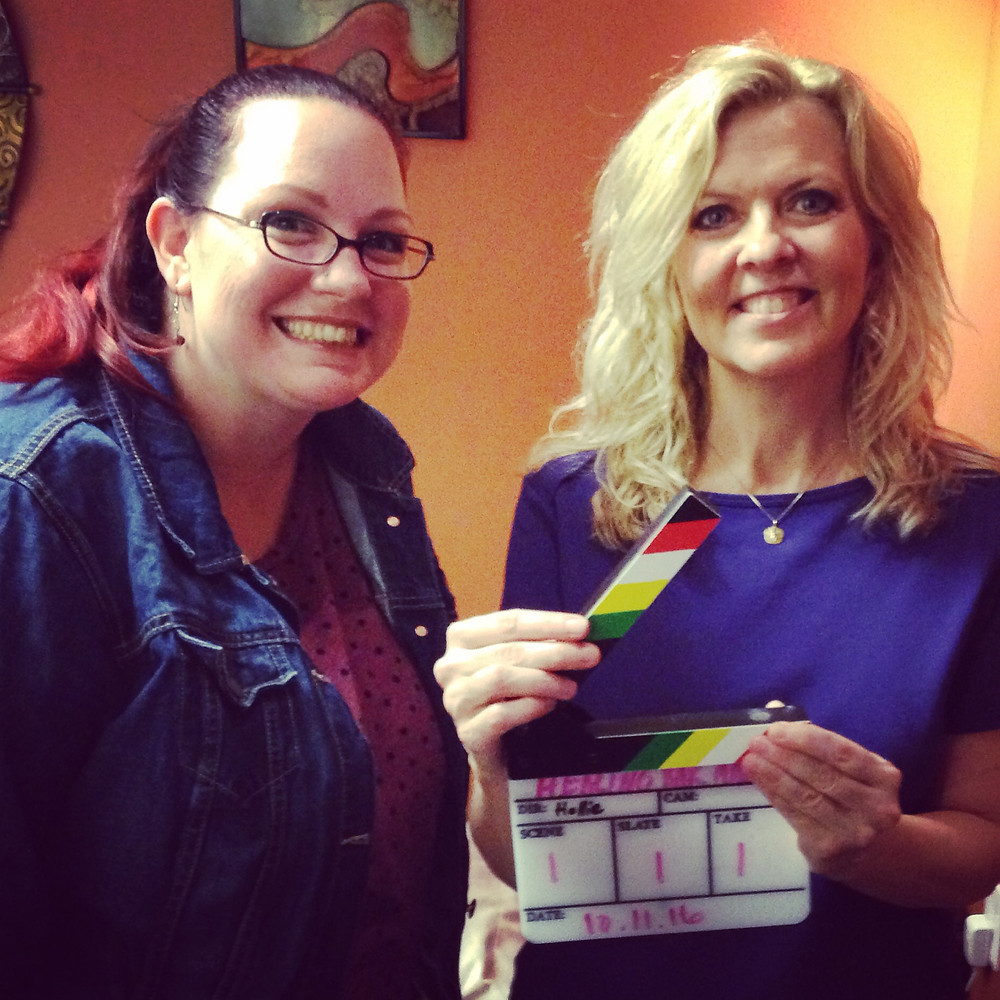 Kim Geracioti behind the scenes smiling with Hollie Brubaker.