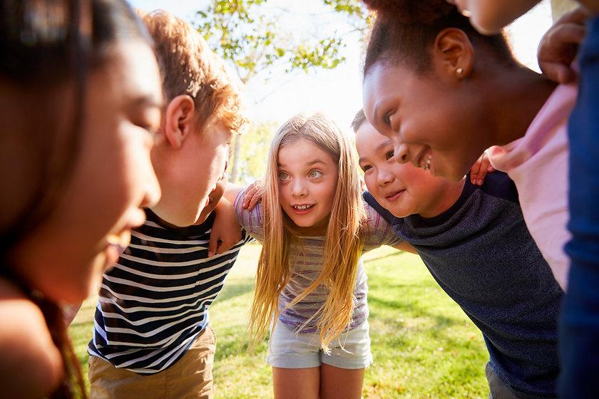 multi-ethnic-group-of-kids-embracing-loo