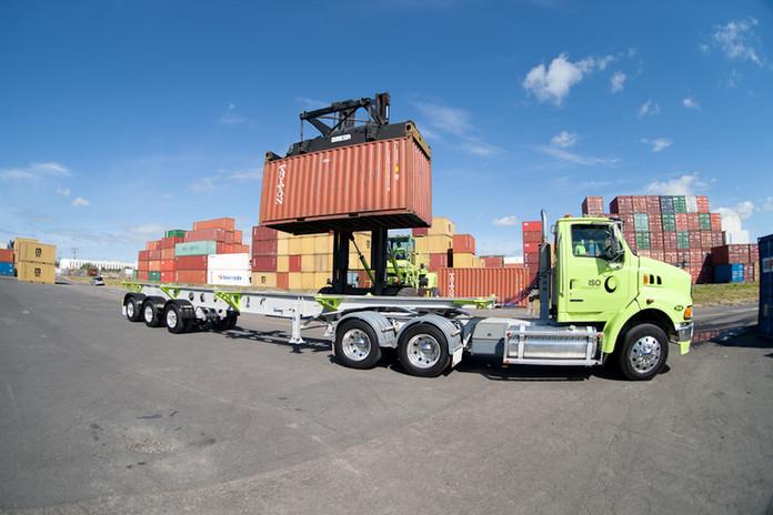 Container lifting onto truck Tauranga.jp