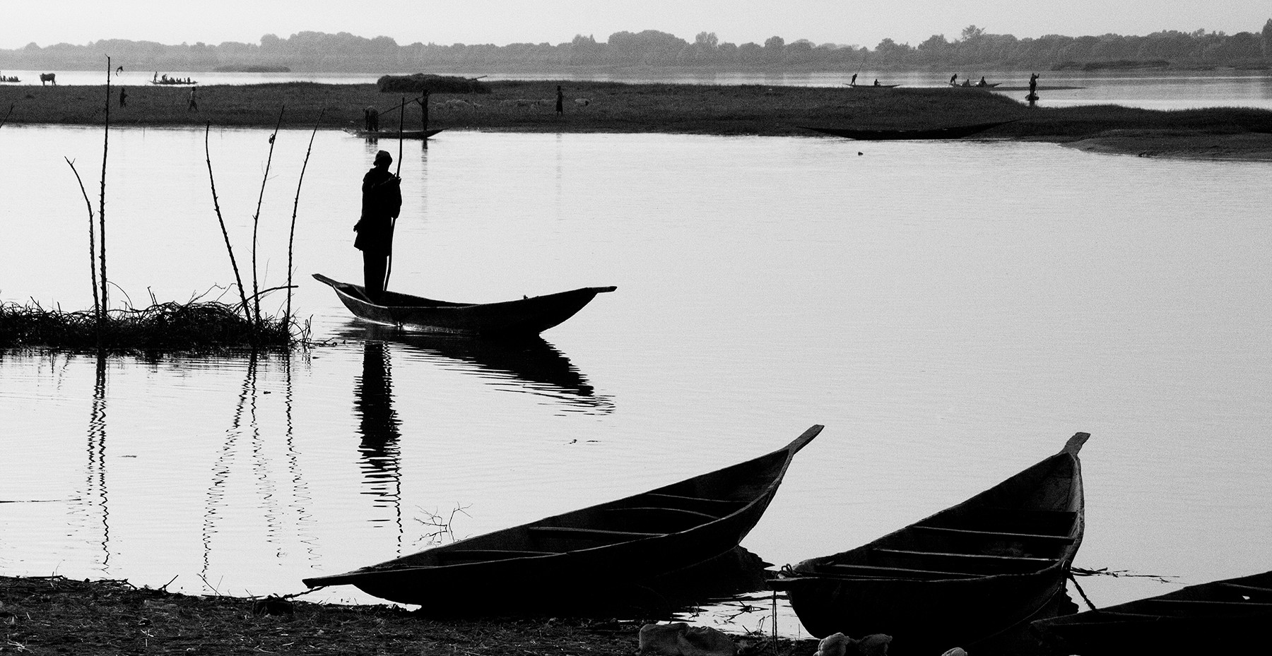 A boatman waits patiently for customers needing to cross. Gliding over its surface in a hand hewn boat powered by a long pole in the strong, sure hands of a man who knows every facet of this river, we felt the immensity of history that has touched these shores and the calm that comes from a life bound by tradition economics and the phyiscal challenges of survival.