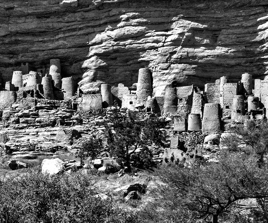 A thousand years ago the Dogon people refused to convert to Islam and retreated to the face of these cliffs to defend their beliefs and way of life. Today they endure as a distinct and thriving culture, well known for their architecture, wooden sculpture, mask dances and religious traditions. The original clay structures and caves on the cliff face were built by the mysterious Tellem people whose cloth and wooden objects are some of the oldest found in Sub Saharan Africa. No one knows what happened to the Tellem, but the Dogon found in these cliffs a defensible home.