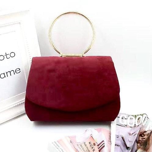 Envelope style evening bag. Burgundy