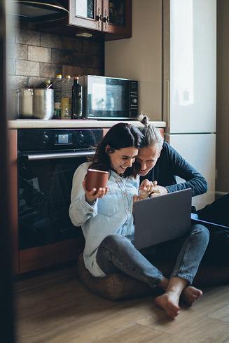 couple-sitting-on-the-kitchen-floor-watc