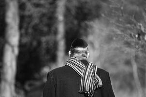 Jewish man in yarmulka and winter coat and scarf