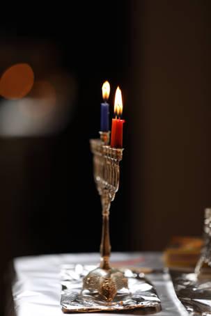 Lit candle menorah