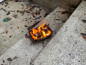 Biur Chometz burning flame on steps