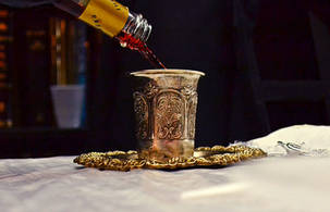 Pouring wine into kiddush cup