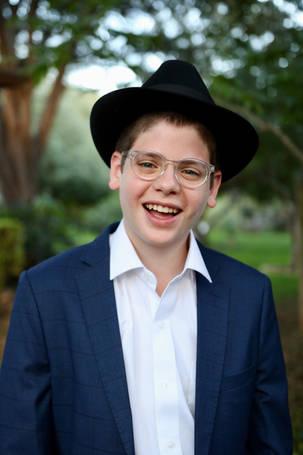 Bar Mitzvah boy portrait smiling