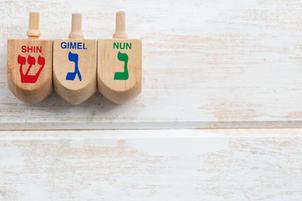 Three wooden dreidels