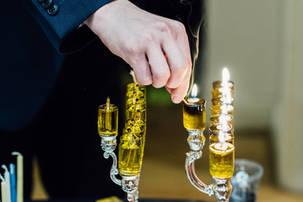 Hand lighting oil menorah