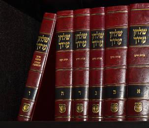 Set of Shulchan Aruch on the shelf