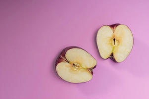 Apple Slices On A Purple Background