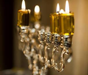 Lit silver oil menorah