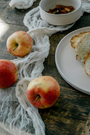 Fresh Bread And Apples On Rustic Table