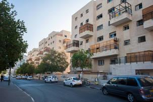 Sukkahs on porches in Israel