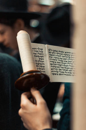 Megillas Esther being read in shul on Purim