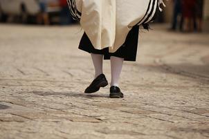 Chassidish man walking in talis