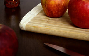 Close up of apples on a cutting board with knife