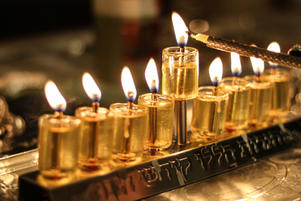 Candle lighting oil menorah on Chanukah
