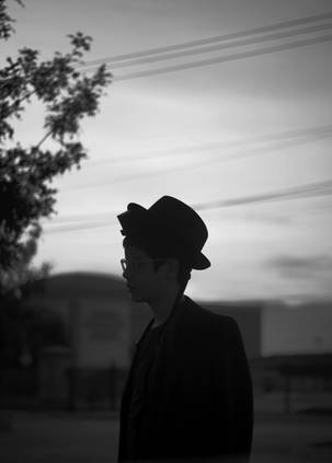 Silhouette of boy wearing hat and tefilin