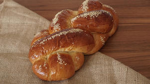 Challah on a wooden table and fabric